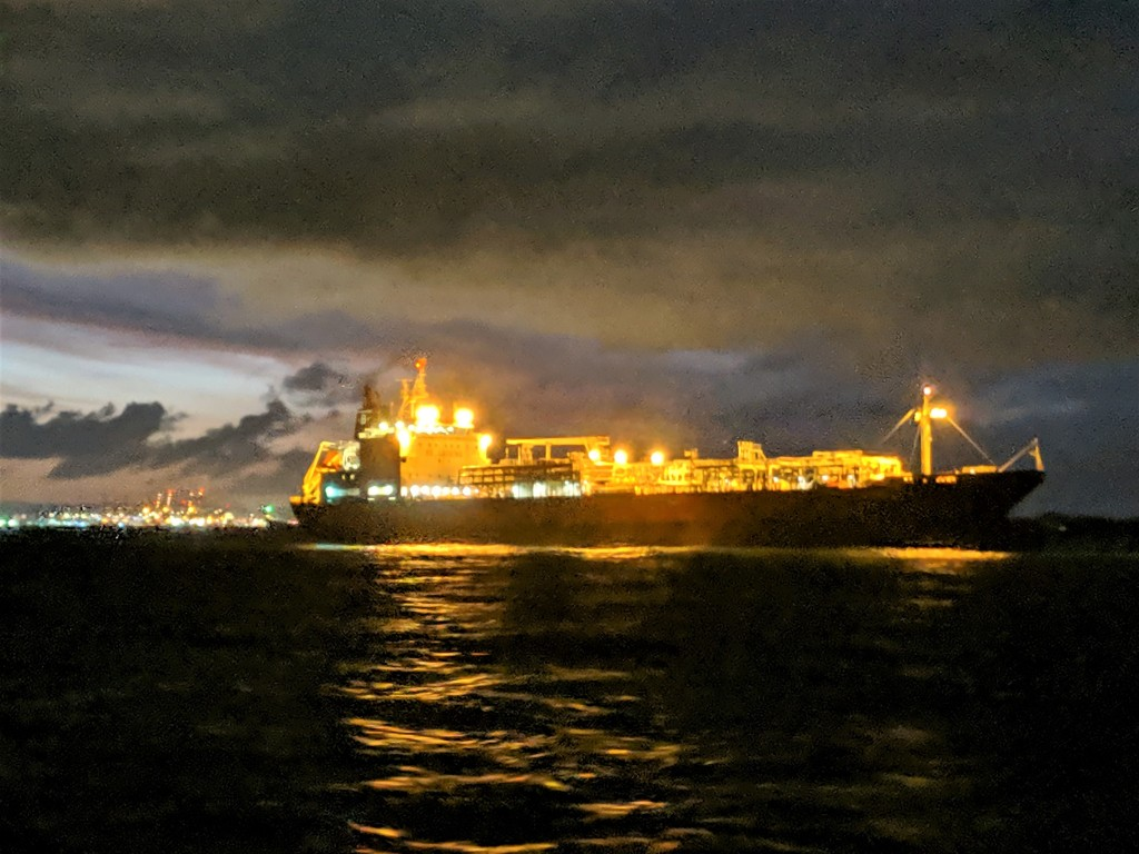 Freighter anchored in Atlantic Anchorage on Night Passage-Bocas to Colon